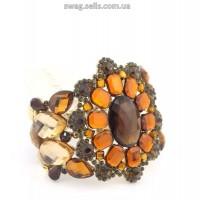 Шикарный золотистый  браслет с  светлыми  и темными коричневыми камнми