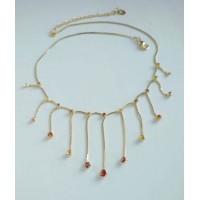 Нежное воздушное  золотое ожерелье с желтыми и коричневыми камнями
