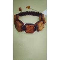 Плетенный браслет унисекс  шамбала  из  медового  янтаря , янтарь натуральный, шнур - черный